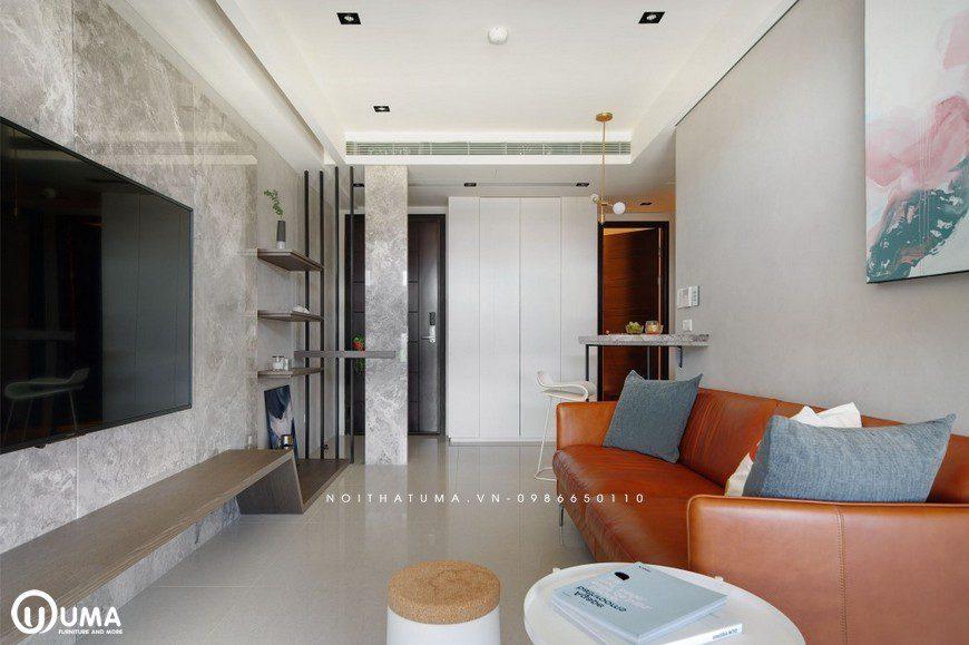 Nổi bật với bộ sofa da màu cam, tạo ra điểm nhấn ngay tại căn phòng