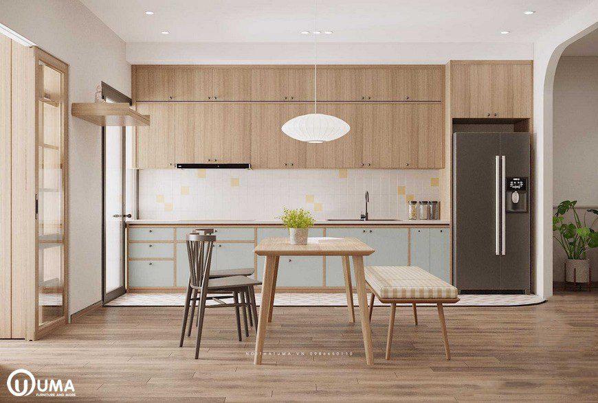Phòng bếp được thiết kế hình chữ I, với điểm nhấn màu xanh, đã tạo ra màu sắc nổi bật ngay trê tủ bếp