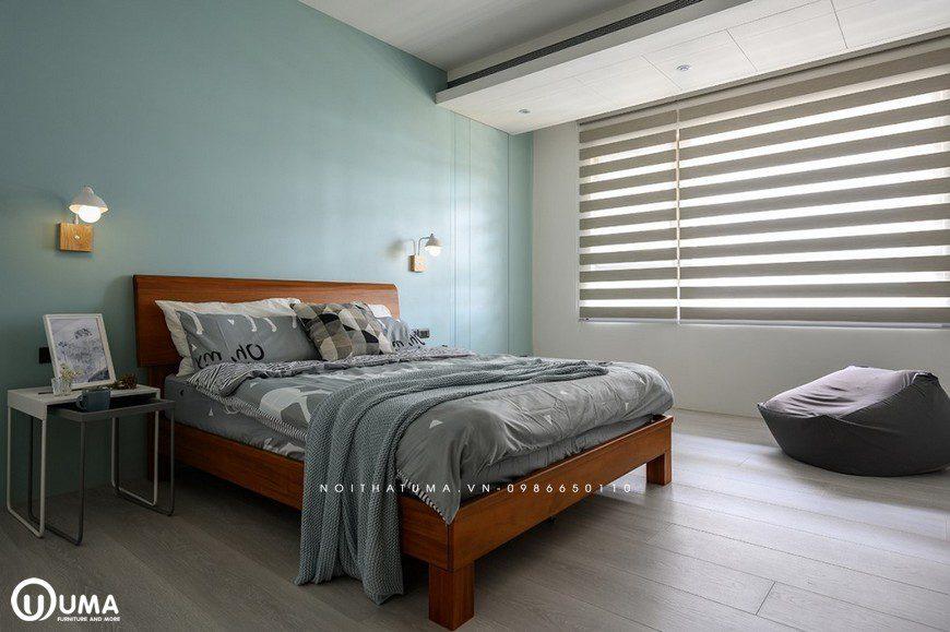 Phòng ngủ này chị thiết kế khá đơn giản chỉ với chiếc giường đơn giản, được trang bị cùng bộ chăn ga gối đệm màu xám