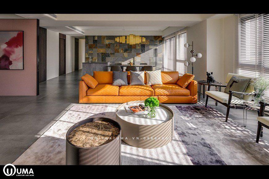 Điểm nhấn nổi bật của không gian này, vẫn là bộ sofa với màu cam khá nổi bật