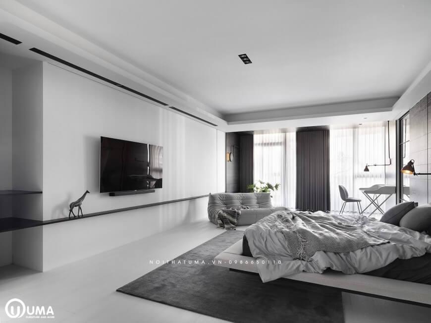 Giữa sàn nhà được trải tấm thảm nhung màu xám đen là điểm nhấn trong tâm của căn phòng