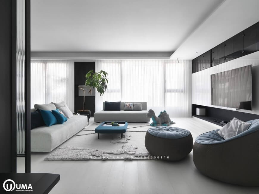 Tổng thể không gian phòng khách được thiết kế khá thân thiện, hài hòa, với bộ sofa nỉ màu trắng sữa