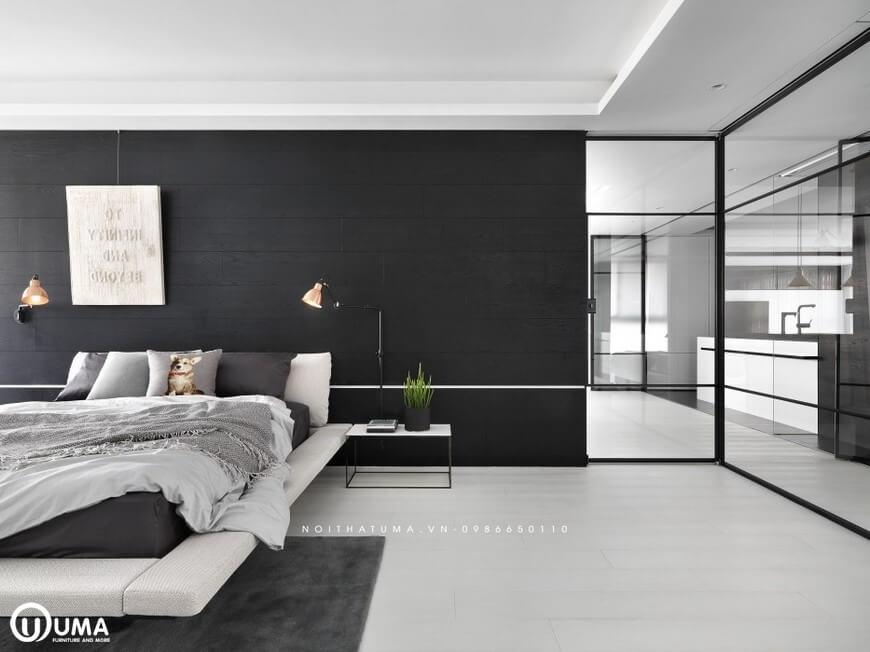 Phần đầu giường được thiết kế với mảng tường màu đen là màu chủ đạo nhất của toàn bộ nội thất.