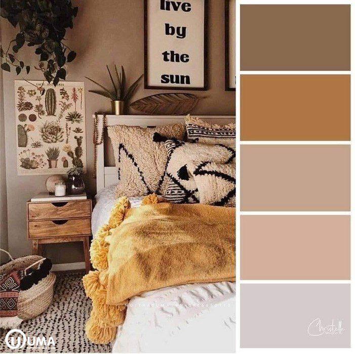 Màu nâu đất trong không gian phòng ngủ là điểm nhấn, kết hợp với bộ đệm trắng.