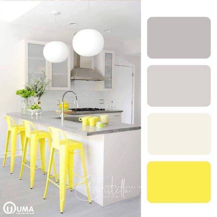 Màu trắng sữa bao phủ toàn bộ không gian bếp, kết hợp màu vàng chói làm điểm nhấn.