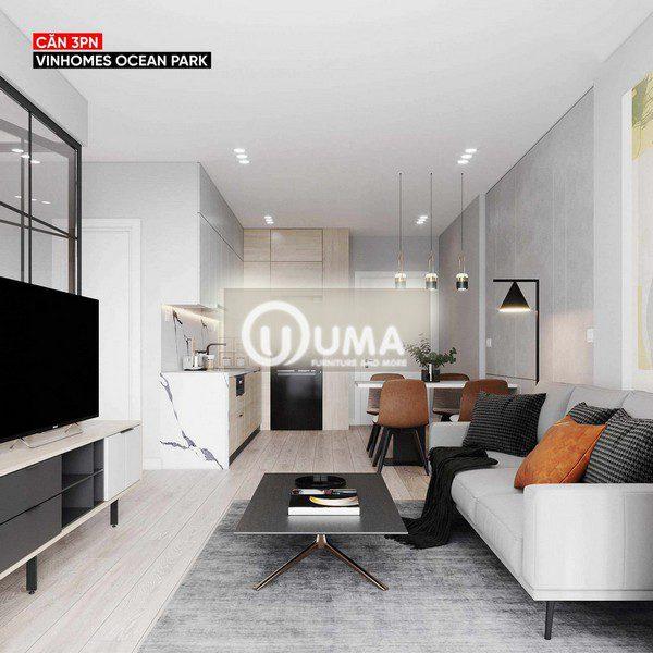 Phòng khách được thiết kế cũng nhẹ nhàng với chiếc bạn đơn giản đặt trên thảm xám, cùng chiếc sofa màu trắng sữa.