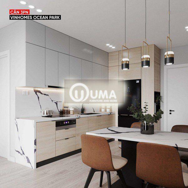 Phần tủ bếp được thiết kế theo hình chữ L, ngay bên hướng cửa đi vào, giúp tiết kiệm không gian tiện tích tối đa.