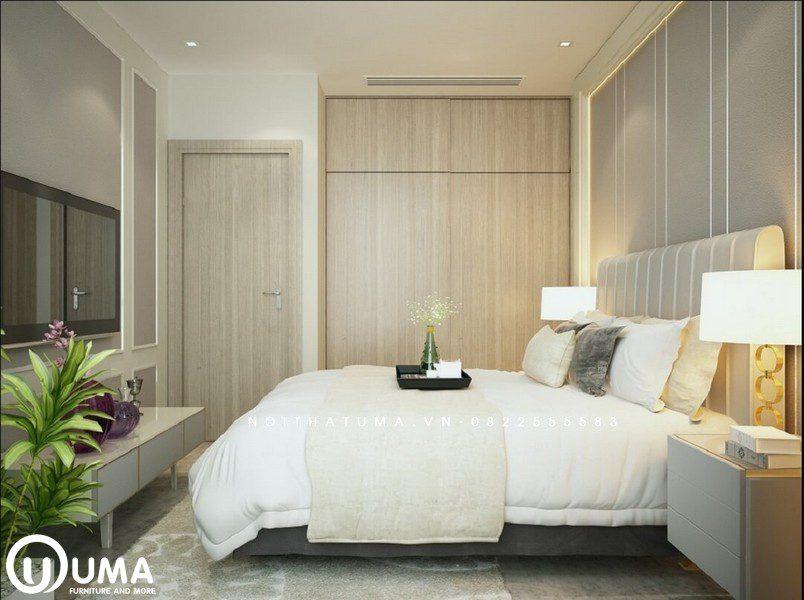 Phòng ngủ được lựa chọn với tông màu chủ đạo là màu trắng của đệm kết hợp với màu xám nhẹ nhàng của không gian phòng ngủ.