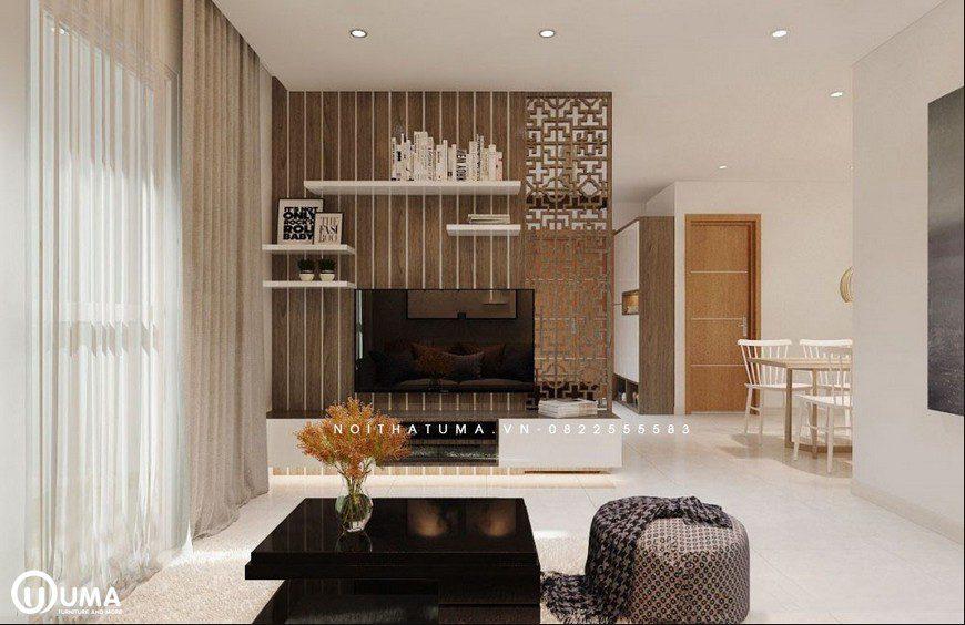 Không gian phòng khách cũng khá ấn tượng và trang hoàng cùng chiếc kệ tivi đơn giản.