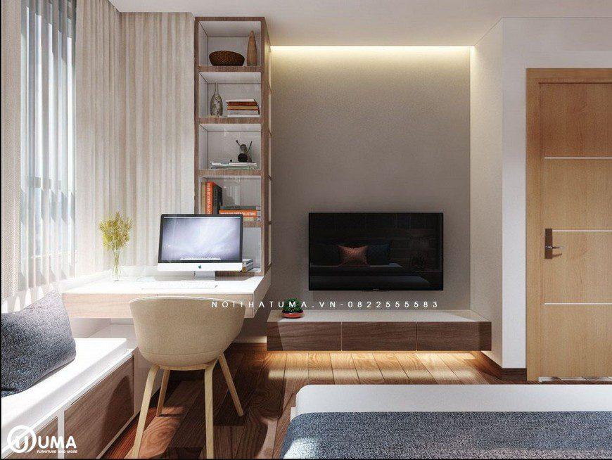 Đối diện với giường ngủ là không gian bàn làm việc và kệ tivi được bố trí cũng khá gọn gàng.