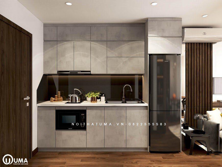 Không gian phòng bếp cũng được thiết kế ngay cửa ra vào khá gọn gàng.