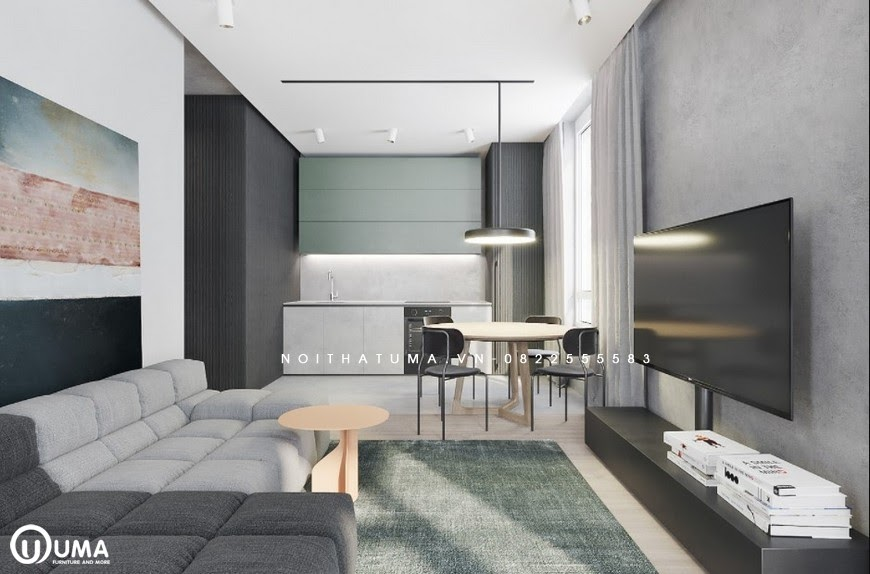 Không gian phòng khách được thiết kế với bố sofa nằm trên chiếc thảm màu xanh xám, đối diện là kệ tivi được trang bị khá hiện đại.
