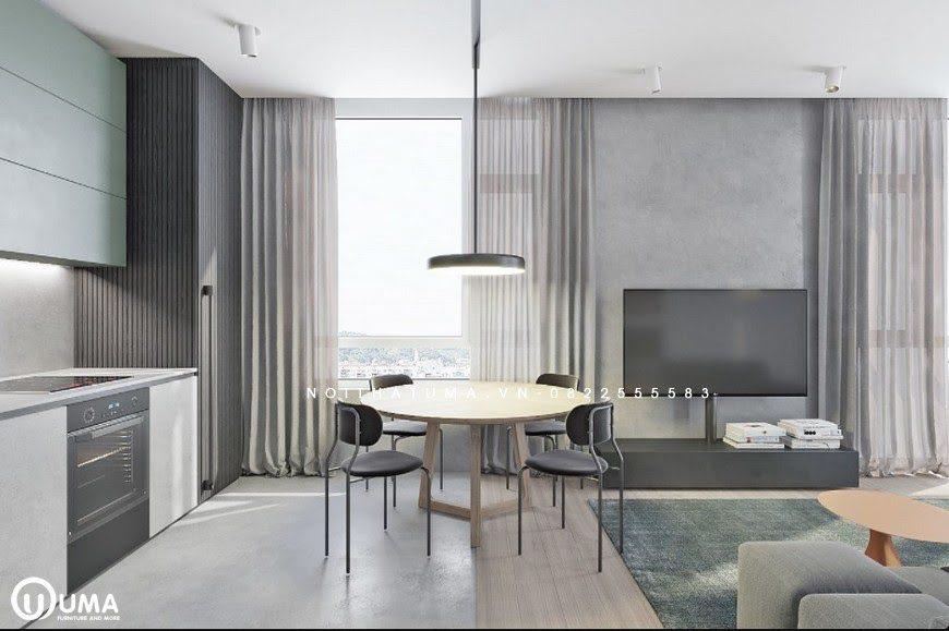 Bàn ăn được lựa chọn loại bàn tròn đặt ngay hướng cửa ban công, hưởng trọn ánh sáng tự nhiên chiếu vào. Được thiết kế đặt bên cạnh bếp hình chữ I của không gian sang trọng.