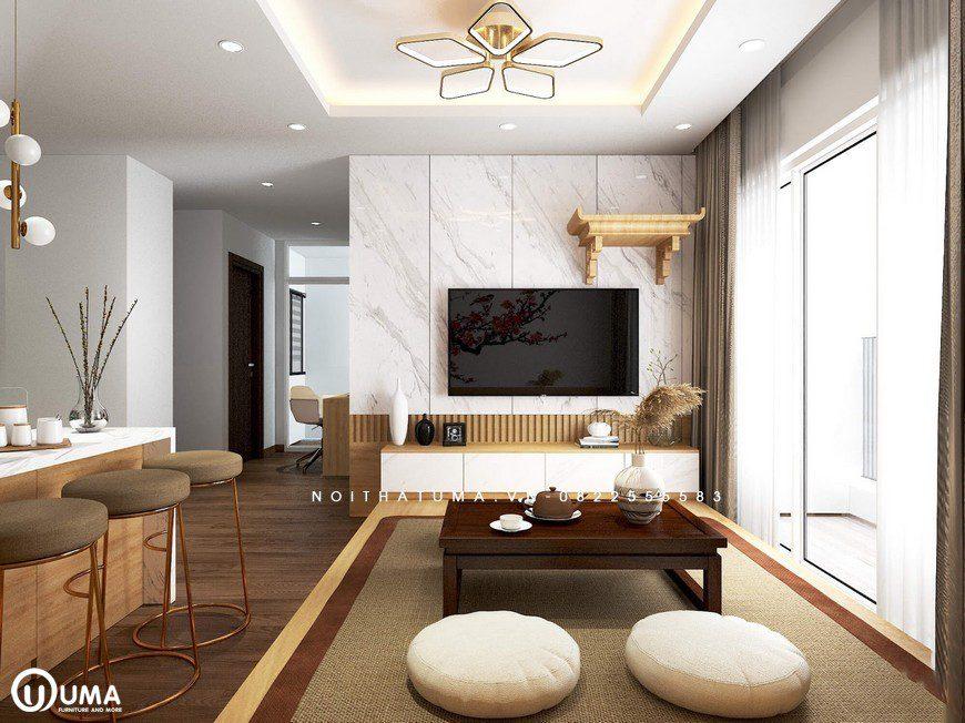 Phòng khách được thiết kế với kiểu dáng bàn nhật, đơn giản được đặt trên chiếc thảm nhẹ nhàng với 2 chiếc ghế bông tròn. Đối diện là kệ tivi treo tường nhẹ nhàng và gọn gàng.