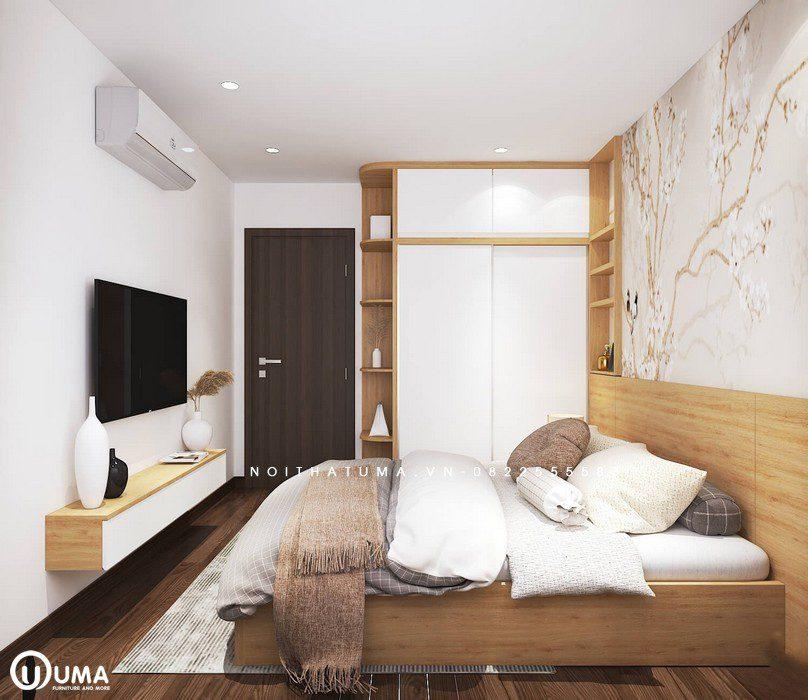 Vào phòng ngủ được thiết kế theo phong cách hiện đại, với giường hộp, tủ để đồ lắp sát vào tường.