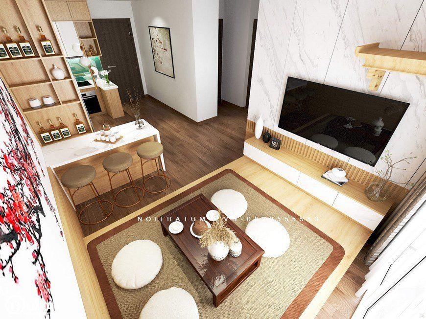 Nhìn tổng thể phòng khách được thiết kế sát bên cạnh phòng bếp, ngăn cách bởi quầy bar, trong cùng không gian thông thoáng.