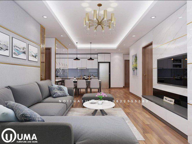Phòng khách được thiết kế khá nhẹ nhàng và ấn tượng, với bộ sofa màu xám chữ L.