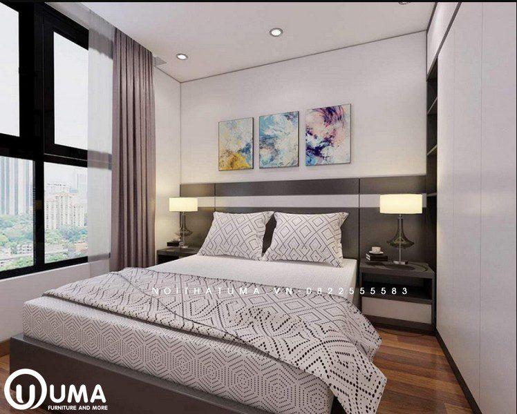 Chiếc giường hộp đặt giữa phòng, với táp đầu giường được thiết kế cùng màu sắc xám tạo ra điểm nhấn cho nơi đây.