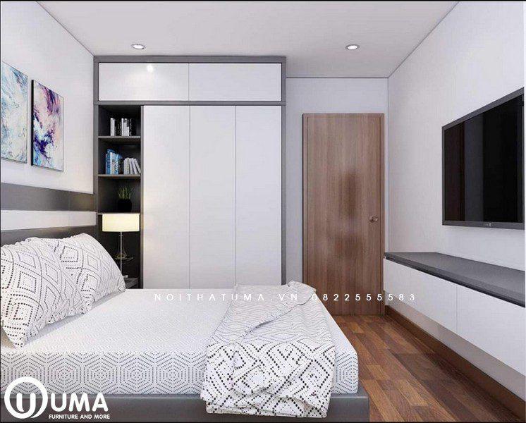 Chiếc giường hộp được đặt giữa phòng, đối diện là kệ tivi, bên cạnh là chiếc tủ để đồ màu trắng khá ngăn nắp.