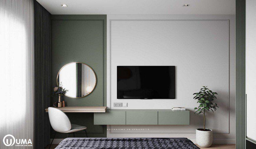 Đối diện với chiếc giường là bộ kệ tivi, cùng với bàn trang điểm được trang trí khá hiện đại, ngăn lắp