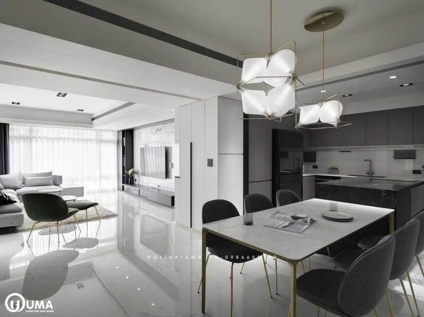 Giữa không gian bàn ăn và phòng khách được ngăn cách nhau bởi lối đi thông thoáng và thoải mái của căn hộ.